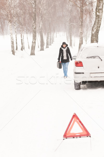 Woman walking with gas can car snow Stock photo © CandyboxPhoto