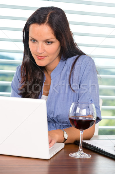 Young businesswoman relaxing home wine surfing internet Stock photo © CandyboxPhoto