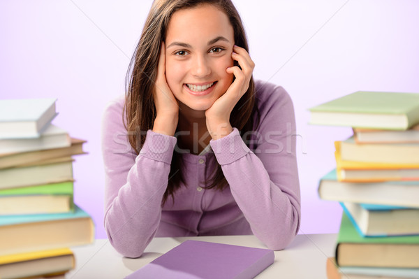 Smiling student girl between piles of books Stock photo © CandyboxPhoto