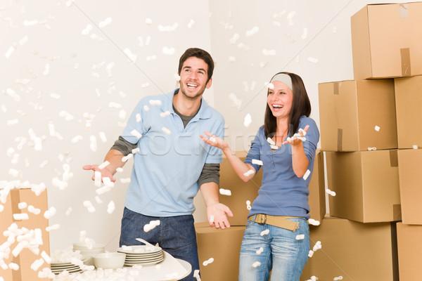 Move home cheerful couple throw Styrofoam peanuts Stock photo © CandyboxPhoto