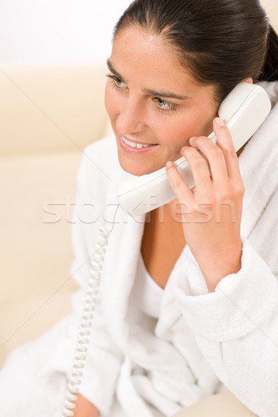 Attractive mid-aged woman on phone wear bathrobe Stock photo © CandyboxPhoto