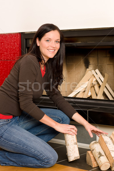 Home fireplace woman put logs happy winter Stock photo © CandyboxPhoto