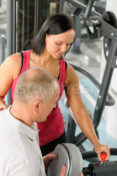 Fitness trainer adjust machine active man exercise Stock photo © CandyboxPhoto