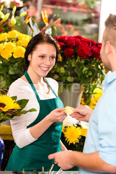 Sonriendo florista hombre cliente compra flores Foto stock © CandyboxPhoto