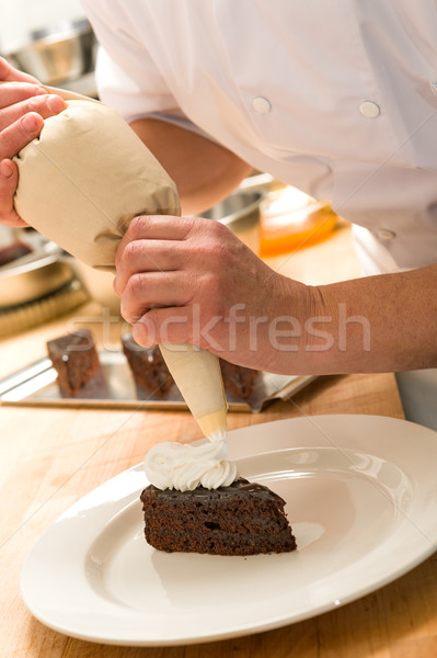 Cook decorating cake with whipped cream Stock photo © CandyboxPhoto