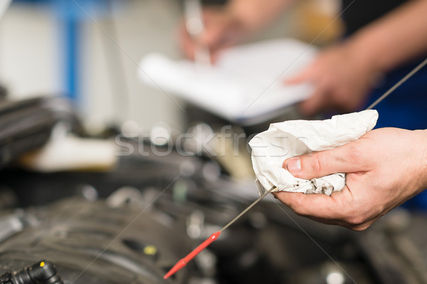 Hand of car mechanic checking oil  Stock photo © CandyboxPhoto