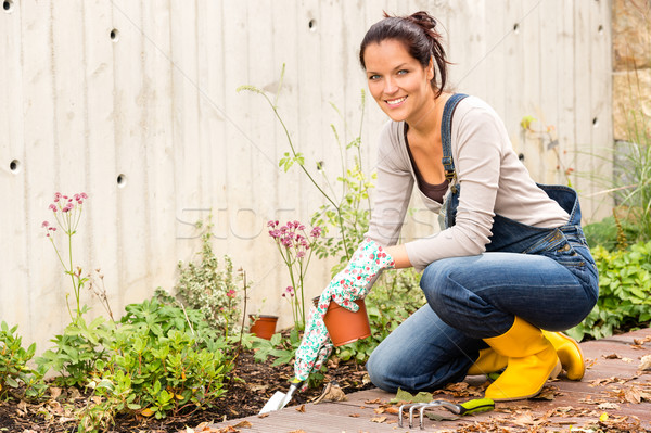 Smiling woman gardening backyard hobby small tools Stock photo © CandyboxPhoto