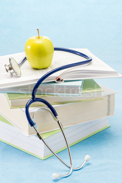 Сток-фото: медицинской · книгах · яблоко · стетоскоп · исследований