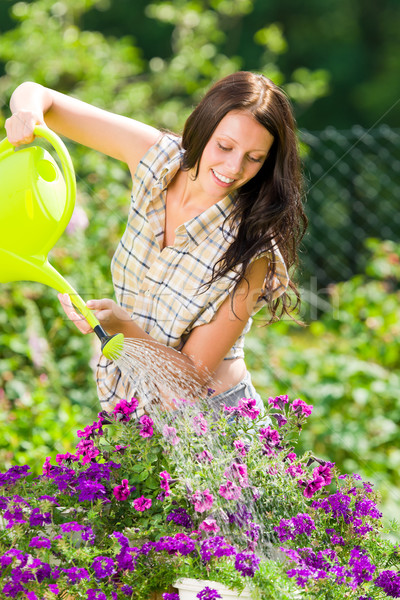 Gardening smiling woman watering can violet flower Stock photo © CandyboxPhoto