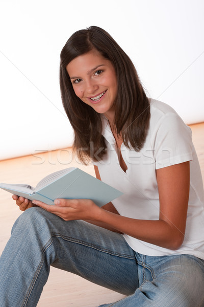 Happy teenager sitting with book Stock photo © CandyboxPhoto