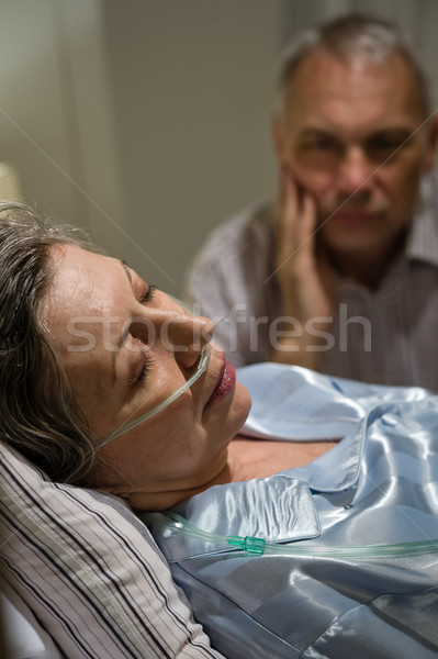 Dying woman in bed with caring man Stock photo © CandyboxPhoto