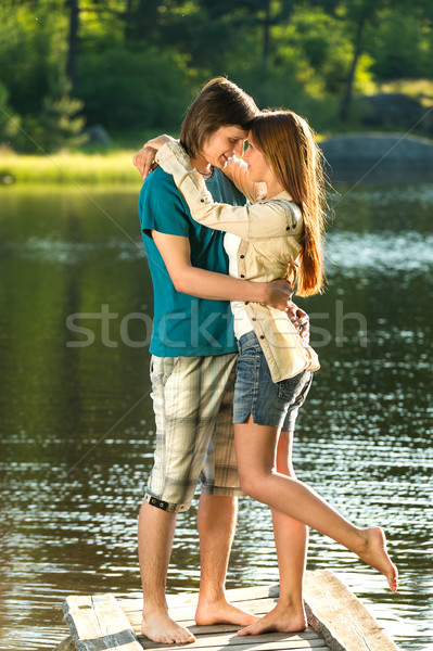 Embracing teens standing barefoot on pier Stock photo © CandyboxPhoto