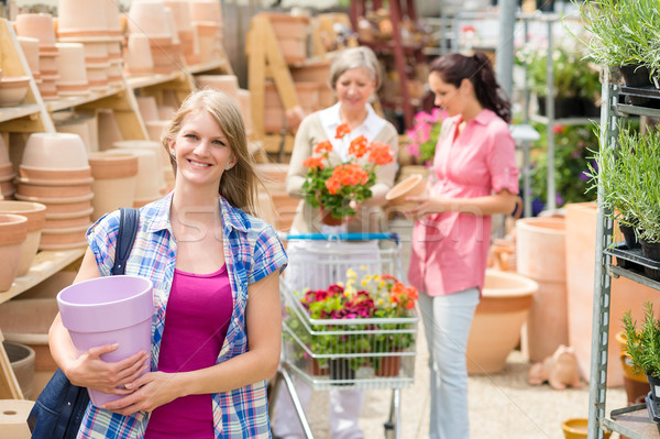 Woman holding purple pot in garden center Stock photo © CandyboxPhoto