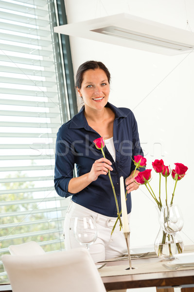 Happy woman putting bouquet dinner table Stock photo © CandyboxPhoto