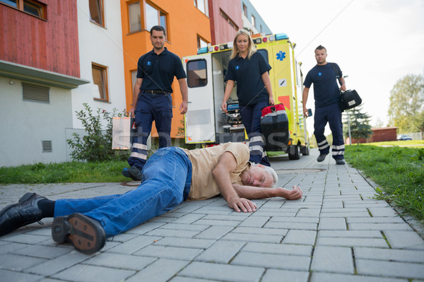 Paramedics giving help to injured senior man Stock photo © CandyboxPhoto