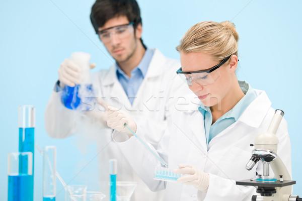 Flu virus experiment -  scientist in laboratory  Stock photo © CandyboxPhoto