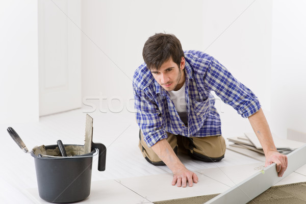 Home tile improvement - handyman with level Stock photo © CandyboxPhoto