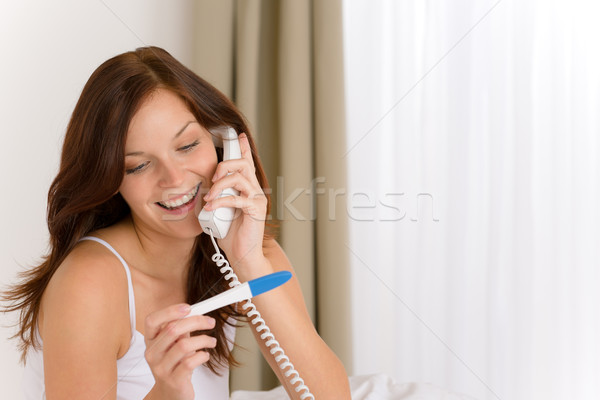 Pregnancy test - happy woman on phone Stock photo © CandyboxPhoto