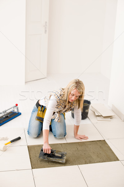 Home improvement, renovation - handywoman laying tile Stock photo © CandyboxPhoto