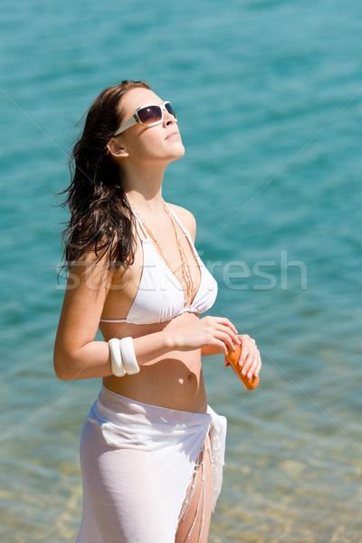 Summer young woman with suncream in bikini Stock photo © CandyboxPhoto