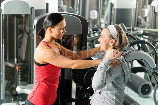 Fitness center senior woman exercise with trainer Stock photo © CandyboxPhoto
