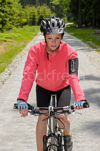 Woman riding mountain bike sunny countryside path Stock photo © CandyboxPhoto