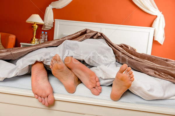 Napping couple barefoot lying under covers bed Stock photo © CandyboxPhoto