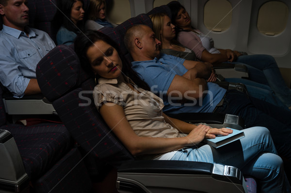 Flight passengers sleep plane cabin night travel Stock photo © CandyboxPhoto