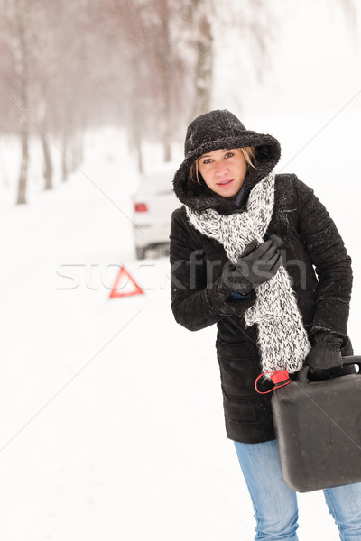 Woman holding gas can winter car breakdown Stock photo © CandyboxPhoto