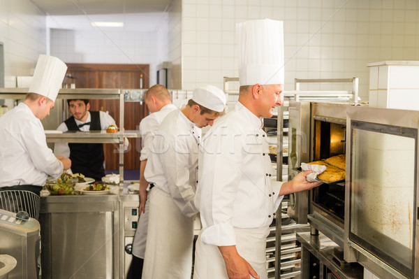 Group of cooks in professional kitchen Stock photo © CandyboxPhoto