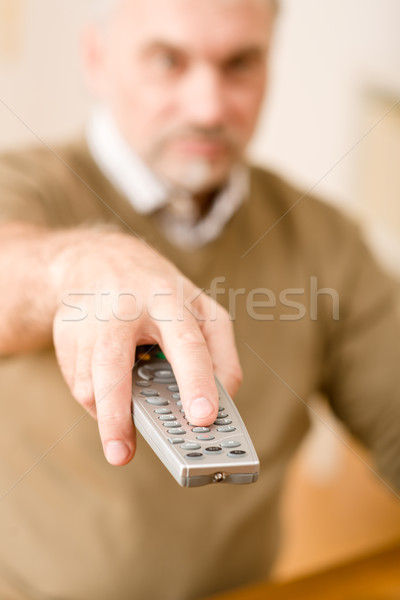 Senior mature man holding remote control Stock photo © CandyboxPhoto