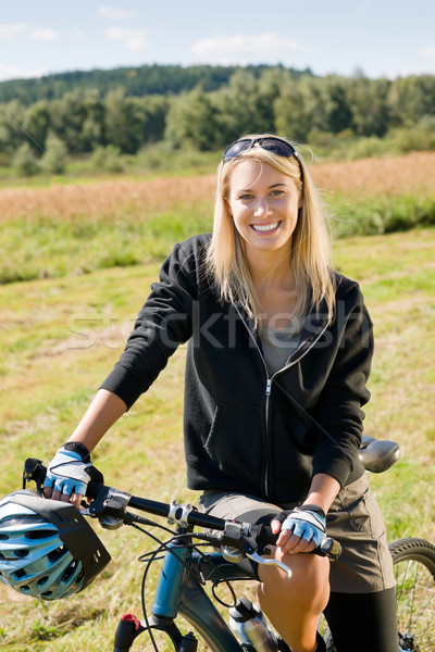 Mountain biking young woman sportive sunny meadows Stock photo © CandyboxPhoto