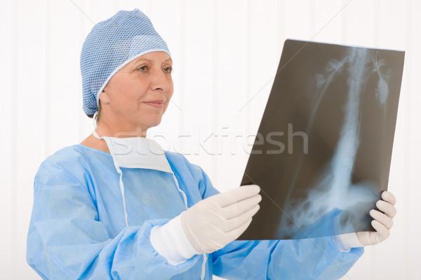 Stock photo: Senior surgeon female hold x-ray protective overall