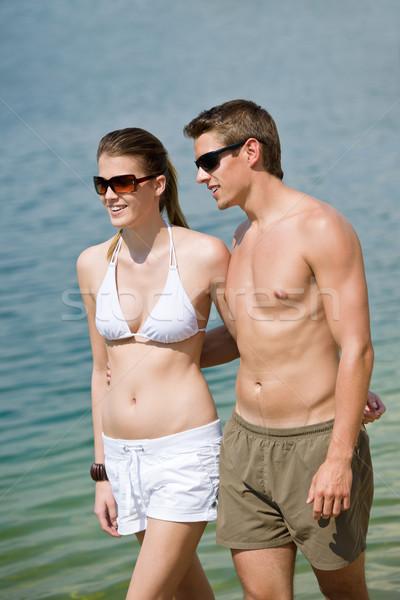 Happy couple in swimwear walk in lake Stock photo © CandyboxPhoto