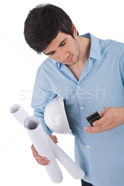 Stock photo: Male architect student with helmet and plans