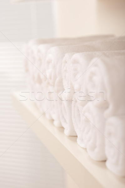 Line of rolled up white bath towels Stock photo © CandyboxPhoto