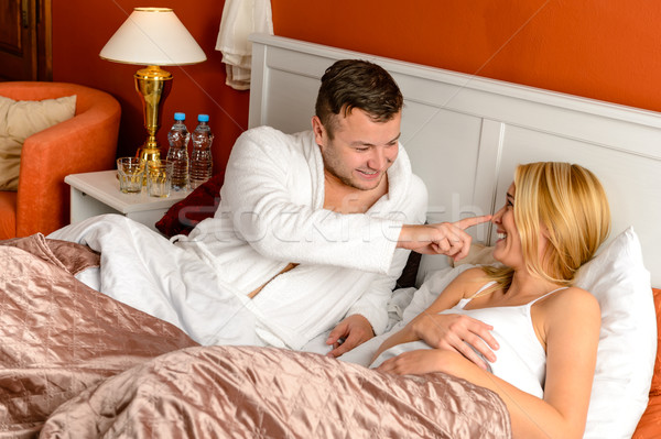 Young man stroking woman lying bed happy Stock photo © CandyboxPhoto