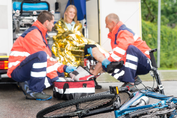Accident bike woman get emergency help paramedics Stock photo © CandyboxPhoto