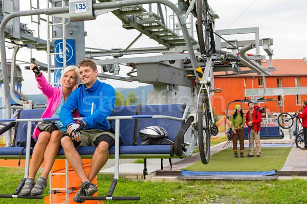 Happy couple traveling chair lift enjoying landscape Stock photo © CandyboxPhoto