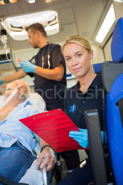 Paramedic helping injured patient in ambulance Stock photo © CandyboxPhoto