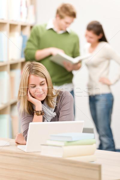 Liceo biblioteca studente laptop femminile libro Foto d'archivio © CandyboxPhoto