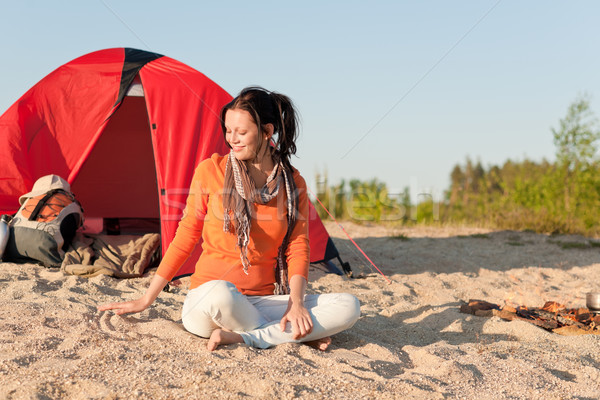 Camping happy woman sitting by campfire on beach  Stock photo © CandyboxPhoto