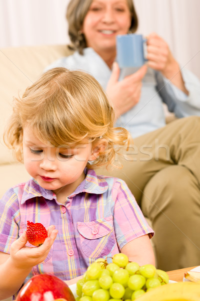 Little girl eat strawberry fruit with grandmother Stock photo © CandyboxPhoto
