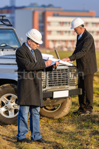Architect man make notes on construction site Stock photo © CandyboxPhoto