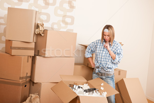Moving house: Young woman unpacking box Stock photo © CandyboxPhoto