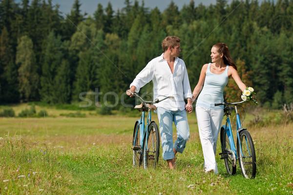 Romantikus fiatal pár  bicikli tavasz Stock fotó © CandyboxPhoto