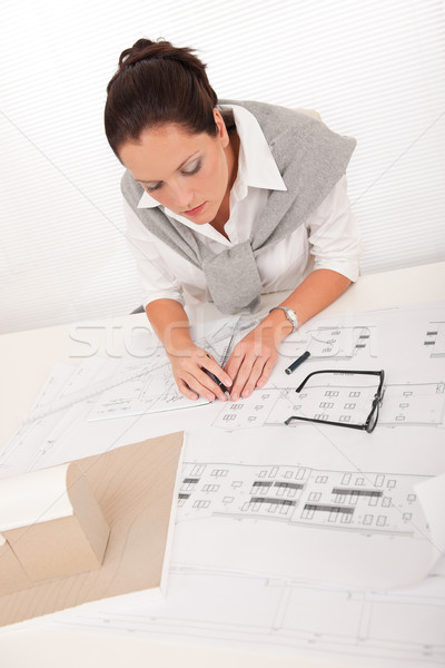 Stock photo: Attractive female architect watching plans