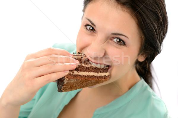Ganancioso mulher jovem alimentação saboroso bolo olhando Foto stock © CandyboxPhoto