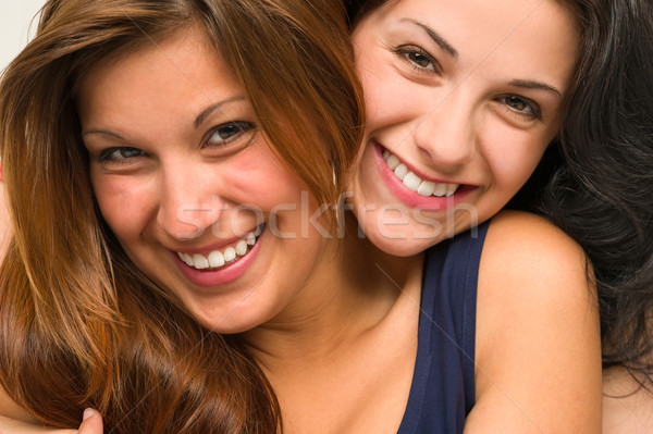 Close up portrait of beautiful girls hugging Stock photo © CandyboxPhoto