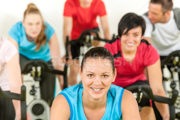 Smiling woman at spinning class fitness workout Stock photo © CandyboxPhoto